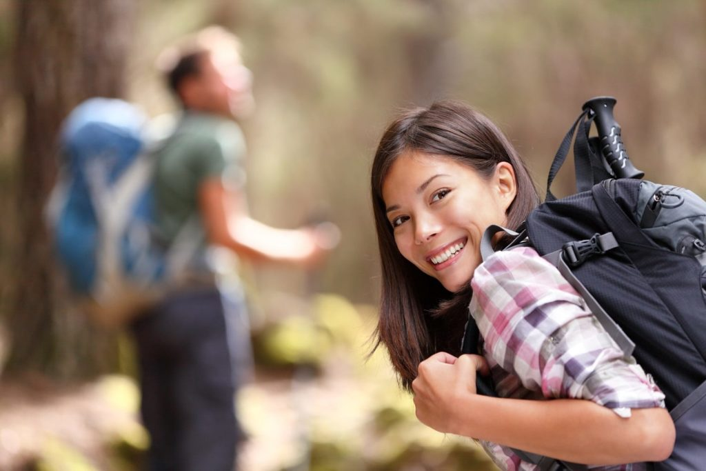 Man and Woman Hiking Down the Atalaya Mountain Trail in Santa Fe