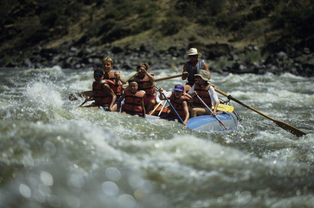 Family Enjoying White Water Rafting in Taos